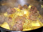 Meatballs with peas and artichoke hearts